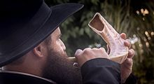 A Man Blowing a Shofar